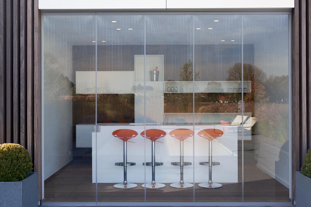 Cortinas de cristal en bar terraza en Bélgica